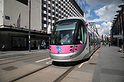 Midland Metro tram public transport system in central Birmingham, United Kingdom. The Midland Metro is a light-rail tram line in the county of West Midlands, England, operating between the cities of Birmingham and Wolverhampton via the towns of West Bromwich and Wednesbury. The line operates on streets in urban areas, and reopened conventional rail tracks that link the towns and cities. The owners are Transport for West Midlands with operation by National Express Midland Metro, a subsidiary of National Express. TfWM itself will operate the service from October 2018.