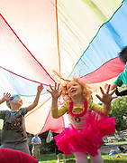 Arnold Lim/News staff<br /> Misha Mainprize (5) and Millie Rogers (4) play under a brightly coloured parachute at St. Christopher Montessori . VICTORIA, B.C. May 16, 2014.
