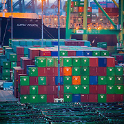 Image of stacked containers and ship in Port of Los Angles.