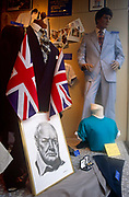A portrait of Sir Winston Churchill is propped up in a shop window display during celebrations for wartime during 50th anniversary celebrations of wartime VE day. The whole country celebrated the 50th anniversary of VE (Victory in Europe) Day on 6th May 1995. In the week near the anniversary date of May 8, 1945, when the World War II Allies formally accepted the unconditional surrender of the armed forces of Germany and peace was announced to tumultuous crowds across European cities, the British still go out of their way to honour those sacrificed and the realisation that peace was once again achieved. Street parties now – as they did in 1945 – played a large part in the country's patriotic well-being.