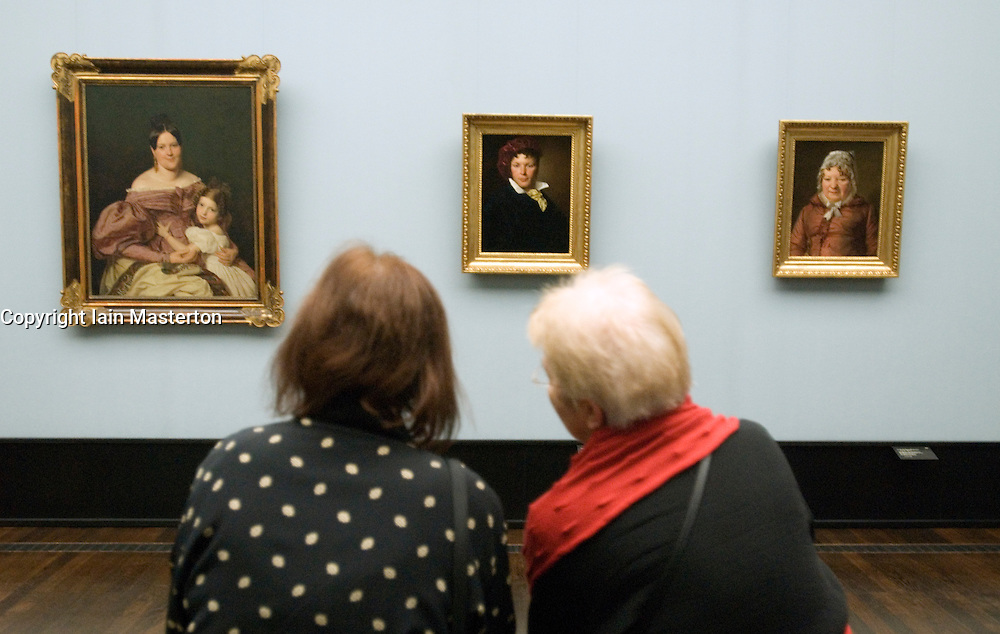 Visitors looking at paintings in Alte Nationalgalerie in Berlin Germany