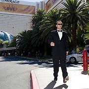 Jonathan Thompson walks past the Mirage hotel where he would enter his 3rd poker tournament, Las Vegas.