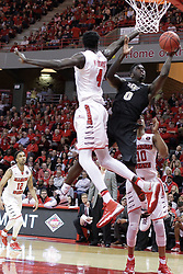 """20 March 2017: Tank Efianayi behind Daouda """"David"""" Ndiaye (4) during a College NIT (National Invitational Tournament) 2nd round mens basketball game between the UCF (University of Central Florida) Knights and Illinois State Redbirds in  Redbird Arena, Normal IL"""