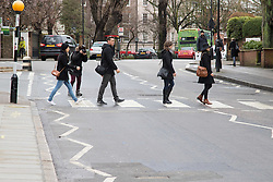 Abbey Road Studios, St John's Wood, London March 9th 2016. Beatles fans, tourists and the media gather outside Abbey Road Studios in London to remember Sir George Martin, who was often referred to as the fifth Beatle. ©Paul Davey<br /> FOR LICENCING CONTACT: Paul Davey +44 (0) 7966 016 296 paul@pauldaveycreative.co.uk