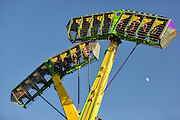 Children hang on as they ride the Kamikaze Pendulum amusement ride at Cheyenne Frontier Days Midway July 25, 2015 in Cheyenne, Wyoming. Frontier Days celebrates the cowboy traditions of the west with a rodeo, parade and fair.