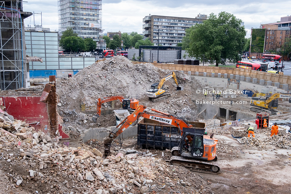 Excavators clear rubble and change the urban landscape on the site of the former Elephant & Castle shopping centre which is being demolished and redeveloped in south London, on 22nd June 2021, in London, England. The much-criticised architecture of the Elephant & Castle Shopping Centre was opened in 1965, built on the bomb damaged site of the former Elephant & Castle Estate, originally constructed in 1898. The centre was home to restaurants, clothing retailers, fast food businesses and clubs where south Londoners socialised and met lifelong partners.