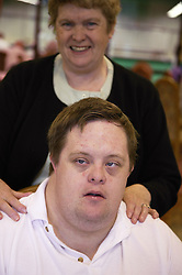 Young man with Downs Syndrome taking part in a bowls event held at Solihull Indoor Bowls Centre,
