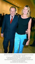 SIR DAVID & LADY CARINA FROST at an exhibition in London on 6th May 2003.PJI 315