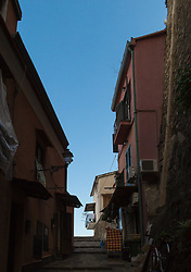 Sorrento, Italy, September 15 2017. Blue sky is revealed from among shady streets in Sorrento, Italy. © Paul Davey