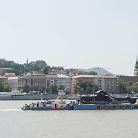 Passenger boat Hableany (means Mermaid in Hungarian) is seen being transported through the city on another boat from the crime scene examination after authorities finished collecting evidences following it's capsize in an accident on river Danube in downtown Budapest, Hungary on June 11, 2019. ATTILA VOLGYI