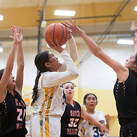 Zuni's Shelby Lalio (11) drives to the basket as Hatch Valley's Tavyn Trujillo (14) defends Saturday at the Rehoboth Christian High School girls basketball tournament championship game in Rehoboth.
