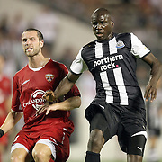 Defender Rob Valentino (L) and Forward Demba Ba (R) square up during an International Friendly soccer match between English Premier League team Newcastle United and the Orlando City Lions of the United Soccer League, at the Florida Citrus Bowl on Saturday, July 23, 2011 in Orlando, Florida. Orlando won the match 1-0. (AP Photo/Alex Menendez)