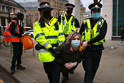 """© Licensed to London News Pictures. 27/03/2021. Manchester, UK. Many police arrive as protesters block trams in St Peter's Square . A """" Kill the Bill """" and Reclaim the Streets demonstration in Manchester City Centre, in opposition to the Police, Crime, Sentencing and Courts Bill 2021 that is currently before Parliament and after the death of Sarah Everard in London . Photo credit: Joel Goodman/LNP"""