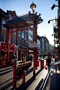 Scene on Gerrard Street, the centre of London's Chinatown. The name Chinatown has been used at different times to describe different places in London. The present Chinatown is in the Soho area of the City of Westminster, occupying the area in and around Gerrard Street. It contains a number of Chinese restaurants, bakeries, supermarkets, souvenir shops, and other Chinese-run businesses.