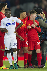 Halbfinale im Liga-Pokal Liverpool vs Leeds 1:0 in Liverpool / 291116<br /> <br /> ***LIVERPOOL, ENGLAND 29TH NOVEMBER 2016:<br /> Liverpool forward Ben Woodburn right who scored the second goal for his side smiles as he stands with teammate Trent Alexander-Arnold centre after the English League Cup soccer match between Liverpool and Leeds at Anfield Stadium in Liverpool England November 29th 2016***