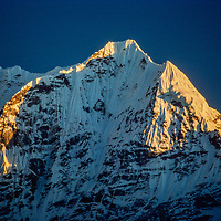 Sunset lights a ridge of Thamserku peak in the Khumbu region of Nepal 1986.