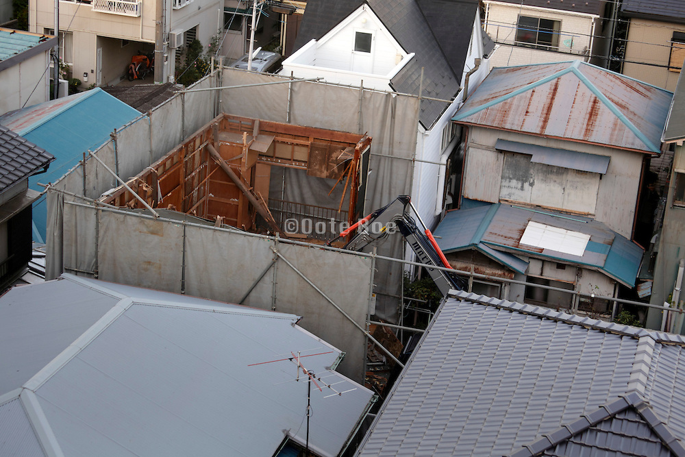 old style wooden structure house being torn down Japan