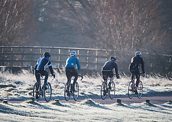 © Licensed to London News Pictures. 16/12/2017. London, UK. A group of cyclists make their way through a frost covered landscape in Richmond Park. Parts of the UK are experiencing freezing temperatures today with snow expected in parts. London, UK. Photo credit: Ben Cawthra/LNP