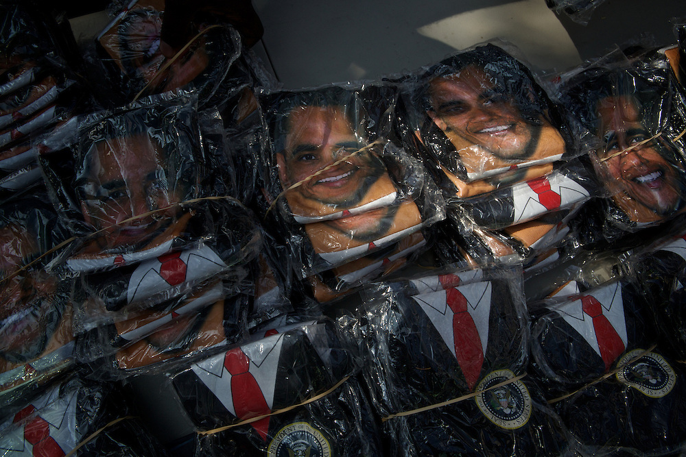 The face of President Barack Obama peaks from  memorabilia on venfor tables surrounding the 2012 Democratic National Convention on Wednesday, September 5, 2012 in Charlotte, NC.