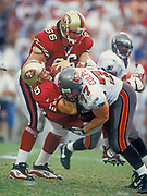 Aug 31,1997; Tampa, Florida, USA;  Quarterback Steve Young of the San Francisco 49ers is sacked by Brad Culpepper of the Tampa Bay Buccaneers at Houlihan's Stadium.