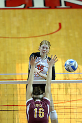 13 September 2011: Shannon McGlaughlin hits past Natalie Pounovich during an NCAA volleyball match between the Ramblers of Loyola and the Illinois State Redbirds at Redbird Arena in Normal Illinois.