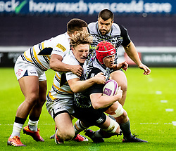 Sam Cross of Ospreys is tackled by Tom Howe of Worcester Warriors<br /> <br /> Photographer Simon King/Replay Images<br /> <br /> European Rugby Challenge Cup Round 5 - Ospreys v Worcester Warriors - Saturday 12th January 2019 - Liberty Stadium - Swansea<br /> <br /> World Copyright © Replay Images . All rights reserved. info@replayimages.co.uk - http://replayimages.co.uk