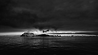 Dark clouds at dawn (02:48 AM) over King George Island. From the deck of the Hurtigruten MS Fram. Image taken with a Leica T camera and 23 mm f/2 lens (ISO 100, 23 mm, f/2.8, 1/125 sec).