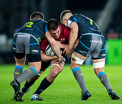 Jean Kleyn of Munster is tackled by Olly Cracknell of Ospreys<br /> <br /> Photographer Simon King/Replay Images<br /> <br /> European Rugby Champions Cup Round 1 - Ospreys v Munster - Saturday 16th November 2019 - Liberty Stadium - Swansea<br /> <br /> World Copyright © Replay Images . All rights reserved. info@replayimages.co.uk - http://replayimages.co.uk