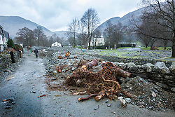 © Licensed to London News Pictures. 08/12/2015. Glen ridding UK. The village of Glenridding has been cut of from the outside world for four days with no water, electricity or telephone lines after huge torrents of water from the surrounding mountains destroyed roads leading to it & flooded the village centre. Photo credit: Andrew McCaren/LNP