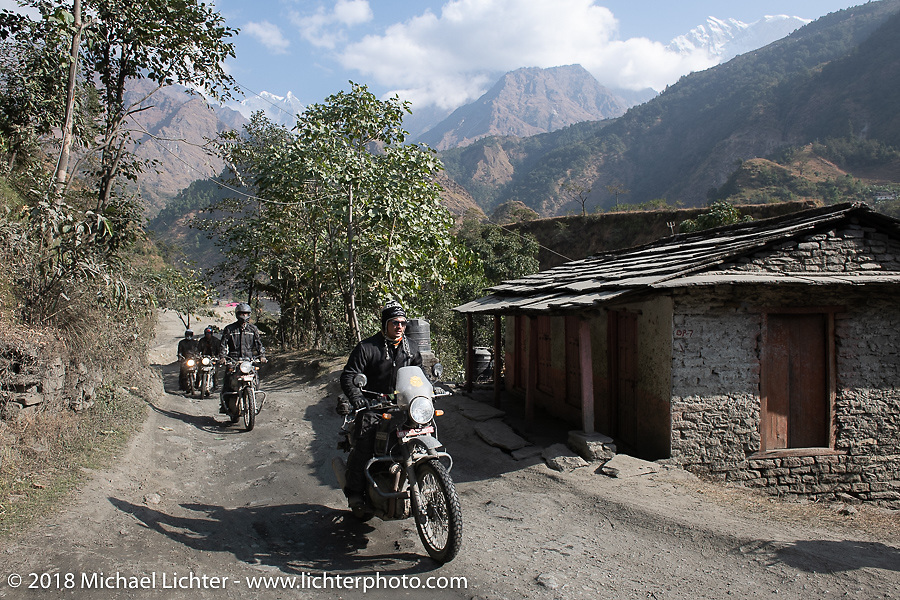 Chris Shelby with the Annapurna Range in the background on Day-7 of our Himalayan Heroes adventure riding from Tatopani to Pokhara, Nepal. Monday, November 12, 2018. Photography ©2018 Michael Lichter.