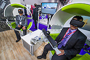 The Airbus Stand with virtual reality simulation pods where users become immersed in three scenarios, using Airbus kit, and viewd through Oculus Rift headsets - The DSEI (Defence and Security Equipment International) exhibition at the Excel Centre, Docklands, London UK 15 Sept 2015