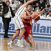 Galatasaray's Ender Arslan (R) during their BEKO Basketball League match Besiktas between Galatasaray at the Sinan Erdem Arena in Istanbul at Turkey on Saturday, December, 17, 2011. Photo by TURKPIX