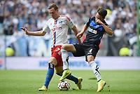 Fotball, 30 August 2014,<br /> Fussball Bundesliga, Hamburger SV - SC Paderborn 07 0:3<br /> v.l. Marcell Jansen  (HSV), Lukas Rupp<br /> <br /> Norway only