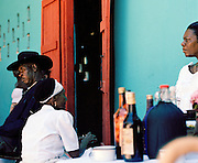 Locals sitting outside a Voodoo ceremony in Port-Au-Prince, Haiti
