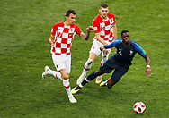 Paul Pogba of France and Mario Mandzukic, Ante Rebic of Croatia during the 2018 FIFA World Cup Russia, final football match between France and Croatia on July 15, 2018 at Luzhniki Stadium in Moscow, Russia - Photo Tarso Sarraf / FramePhoto / ProSportsImages / DPPI