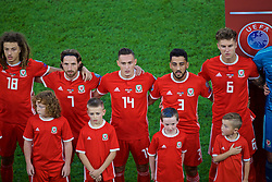 CARDIFF, WALES - Friday, September 6, 2019: Wales players line-up before the UEFA Euro 2020 Qualifying Group E match between Wales and Azerbaijan at the Cardiff City Stadium. L-R: Joe Allen, Connor Roberts, Neil Taylor and Joe Rodon. (Pic by Paul Greenwood/Propaganda)