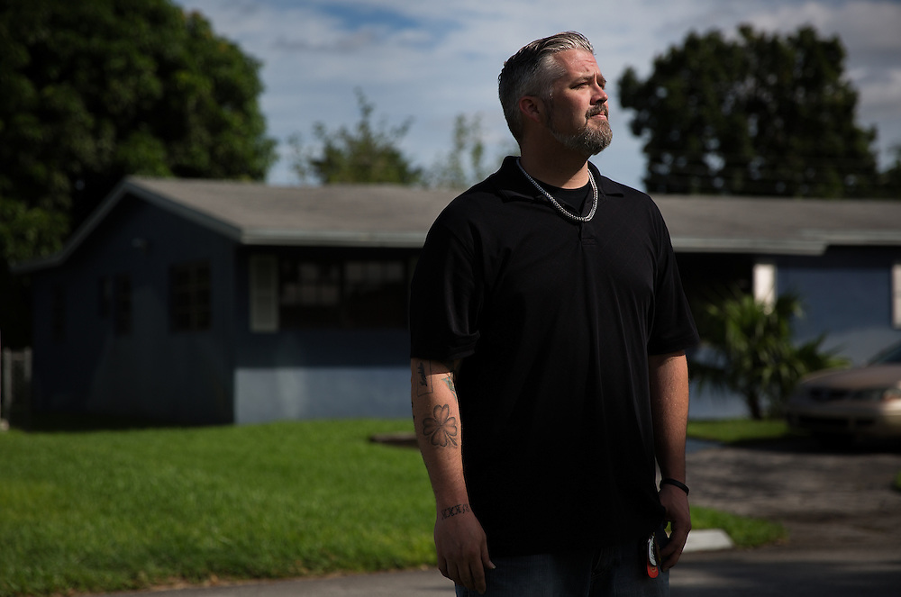Sean Smith, 36, stands in front of his childhood home in Miramar, Fla., where he accidentally shot and killed his 8-year-old sister, Erin. The family has long since moved away from the home which has been repainted and houses new inhabitants. In June 1989, 10-year-old Sean Smith discovered a loaded gun while searching for confiscated video games. It was the first of a wave of shootings that week in Florida that sparked changes in the state's gun safety laws.