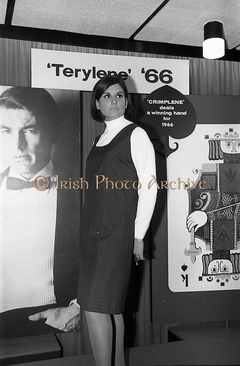 08/02/1966<br /> 02/08/1966<br /> 08 February 1966<br /> Fashion Show at I.C.I. Hawkins House. Lorna wearing Tartan pinafore worn with Bri-Nylon polo-neck jumper.