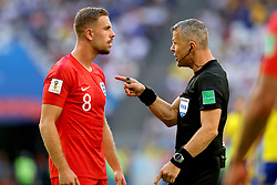 Referee Bjorn Kuipers has a word with England's Jordan Henderson during the FIFA World Cup, Quarter Final match at the Samara Stadium.