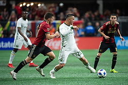 December 8, 2018 - Atlanta, Georgia, United States - Portland Timbers midfielder DAVID GUZMAN (20) dribbles the ball chased by Atlanta United midfielder ERIC REMEDI (11) during the MLS Cup at Mercedes-Benz Stadium in Atlanta, Georgia.  Atlanta United defeats Portland Timbers 2-0 (Credit Image: © Mark Smith/ZUMA Wire)