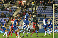 Jussi Jaaskelainen (Wigan) collects the ball under pressure during the Sky Bet League 1 match between Wigan Athletic and Gillingham at the DW Stadium, Wigan, England on 7 January 2016. Photo by Mark P Doherty.