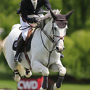 Nicholas Dello Joio riding Caballero 80 in action during the $35,000 Grand Prix of North Salem presented by Karina Brez Jewelry during the Old Salem Farm Spring Horse Show, North Salem, New York, USA. 15th May 2015. Photo Tim Clayton