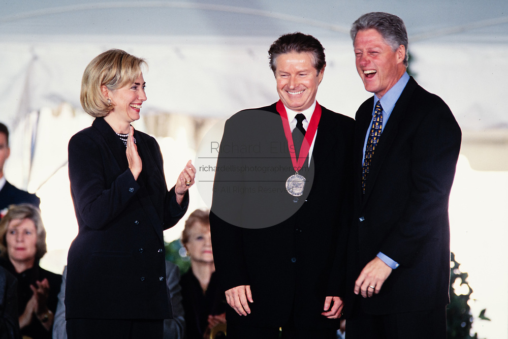 Musician Don Henley of the Eagles is presented the National Medal of Humanities by President Bill Clinton and First Lady Hillary Clinton during a ceremony on the South Lawn of the White House September 29, 1997 in Washington, DC.