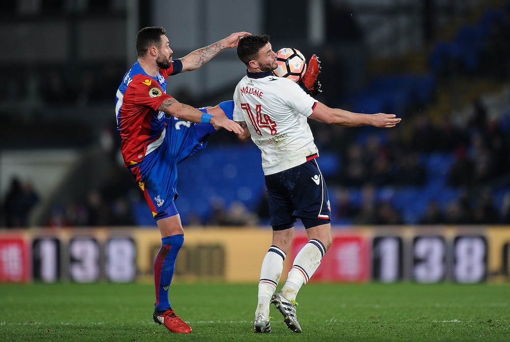 Bolton Wanderers' Gary Madine battles for possession with Crystal Palace's Damien Delaney<br /> <br /> Photographer Ashley Western/CameraSport<br /> <br /> Emirates FA Cup Third Round Replay - Crystal Palace v Bolton Wanderers - Tuesday 17th January 2017 - Selhurst Park - London<br />  <br /> World Copyright © 2017 CameraSport. All rights reserved. 43 Linden Ave. Countesthorpe. Leicester. England. LE8 5PG - Tel: +44 (0) 116 277 4147 - admin@camerasport.com - www.camerasport.com