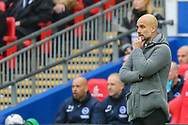 Manchester City manager Pep Guardiola during the The FA Cup semi-final match between Manchester City and Brighton and Hove Albion at Wembley Stadium, London, England on 6 April 2019.