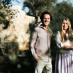 Collette Dinnigan and her husand Bradley Cocks, posing in their villa's garden. Ostuni, Italia. September 28, 2019.