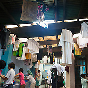 It is laundry day in the center. All the girls are responsible for washing their own clothes and the wash house is busy. Manila, Philippines. Laura Vicuña Foundation, Inc. provides a safe haven, a secure home for girls where they live together with the Salesian Sisters of Don Bosco order. They get the love and care they never have received and psychosocial counseling when needed from qualified psychotherapists. <br /> <br /> The Laura Vicuña Centre in Cubao houses 30 street girls, who may be orphaned, neglected, abandoned, battered, morally endangered and abused. The girls are aged between 6 and 16 and all of them go to school in the local school.