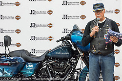 CDR Wiley Cress, USN Ret just after the unveiling at J and L Harley-Davidson of the 2018 Harley-Davidson Street Glide donated by the Motor Company and painted by J and L to commemorate the christening of the USS South Dakota submarine. Sioux Falls, SD. USA. Monday October 9, 2017. Photography ©2017 Michael Lichter.