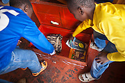 A couple of boy with their personal possessions box at the AFCIC centre in Thika, Kenya. AFCIC - Action for children in conflict, help children who have been affected by various forms conflict or crisis.