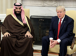 File photo - U.S. President Donald Trump (R) meets with Mohammed bin Salman, Deputy Crown Prince and Minister of Defense of the Kingdom of Saudi Arabia, in the Oval Office at the White House, March 14, 2017 in Washington, DC, USA. A new Saudi anti-corruption body has detained 11 princes, four sitting ministers and dozens of former ministers, media reports say. The detentions came hours after the new committee, headed by Crown Prince Mohammed bin Salman, was formed by royal decree. Photo by Mark Wilson/POOL/ABACAPRESS.COM  | 585821_001 Washington Etats-Unis United States